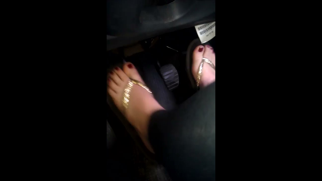 from Mark young women driving car flip flops