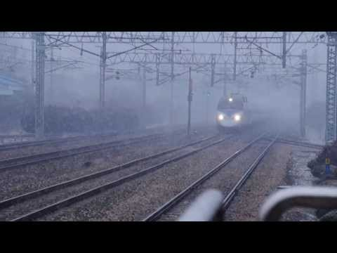Korail KTX train passing Geumjeong