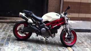 White 2009 Ducati Monster 696 with red frame and Termignoni slip-ons