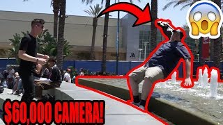 HE FELL IN WITH A $60,000 CAMERA!