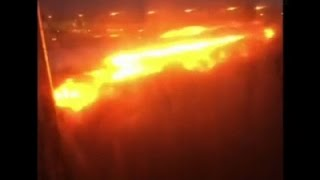 Raw: Singapore Jet Catches Fire After Landing