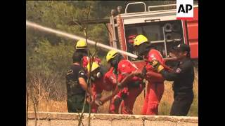 Firefighters scramble to tame raging fires as flames spread