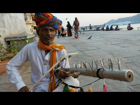 Indian Street Musician at Gangaur Ghat Udaipur.Rajasthani Musical Instrument Ravanahatha Music.India