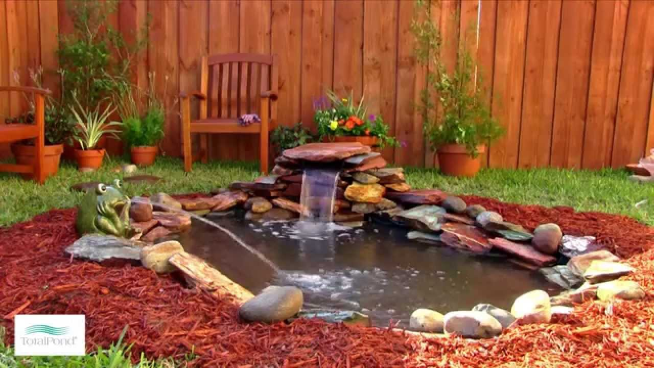 How to add a small waterfall to your pond youtube for Making a garden pond and waterfall