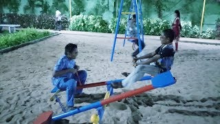 The kids play Swing and Slide with friends at the park