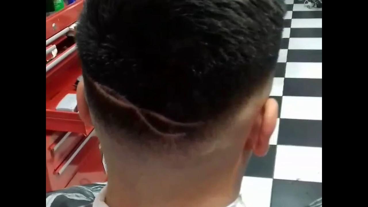 Corte de pelo degradado con rayas