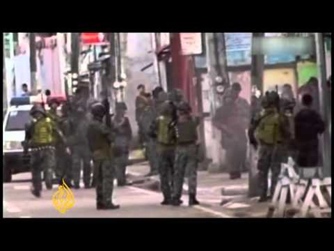 Fighting rages amid Philippine hostage crisis