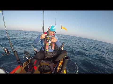 Offshore kayak fishing ,dania beach south florida hook to a big fish or a monster shark.