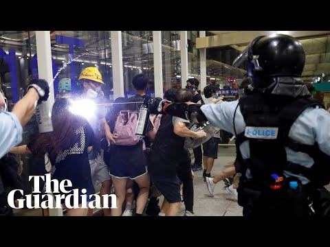 Hong Kong: violence erupts as protesters and riot police clash at airport