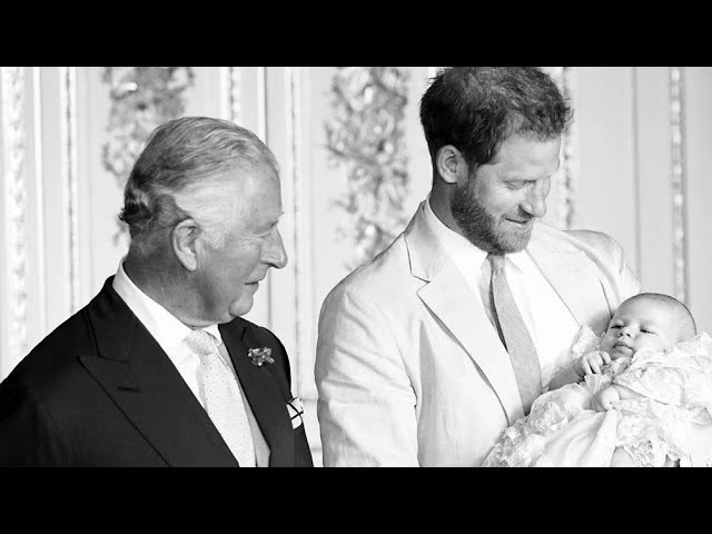 Prince Charles Looks in Awe of Master Archie at Christening