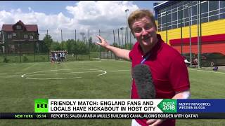 Friendly match: England fans and locals have kickabout in host city