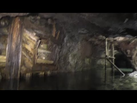 Taking a raft into the deep dangerous  Emma mine and  mine artifacts, old explosive boxes.