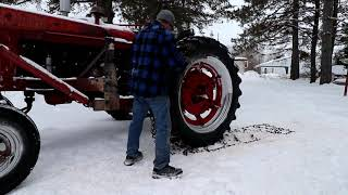 Nstalling Tire Chains On The Farmall M. Not An Easy Task.