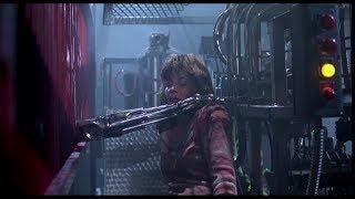 Сара ликвидирует терминатора под прессом.Терминатор.\Sarah kills the terminator under the pressure