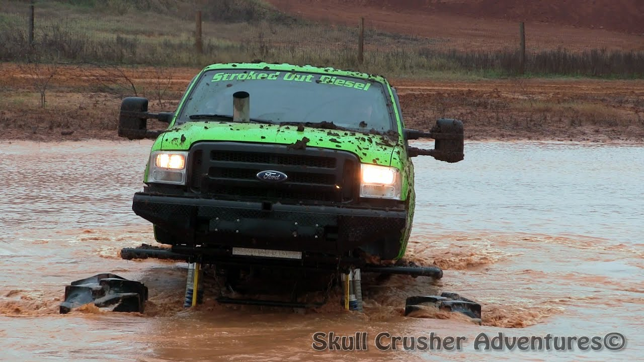 Mega Monster Truck Goes Deep 8 Foot Water Hole Youtube