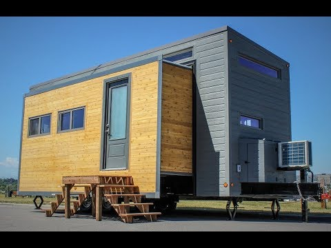 Tiny House Transforms With The Push Of A Button