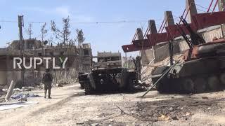 Syria: Abandoned tanks and ruined buildings haunt liberated Douma