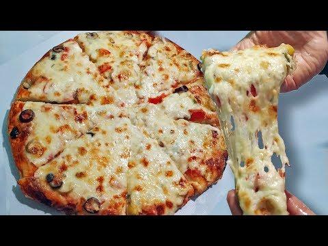 بيتزا المحلات بكل أسرارها جبنة مطاطية عجينة هشةوطرية..من الأخر هخليكي أستاذه فيها
