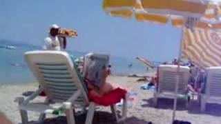 Donut guy on the beach at Hanioti, Halkidiki, Greece(This video should make anyone laugh that's seen or heard this donut guy on Hanioti beach., 2007-07-29T17:33:10.000Z)