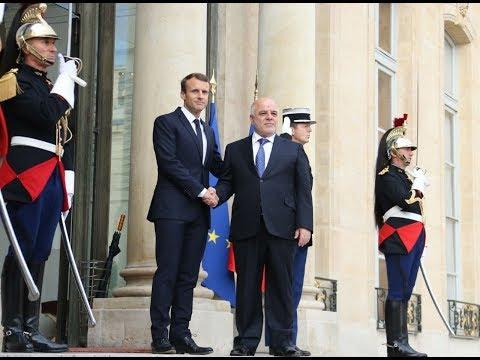 Abadi declares victory in Paris meeting President Emmanuel Macron