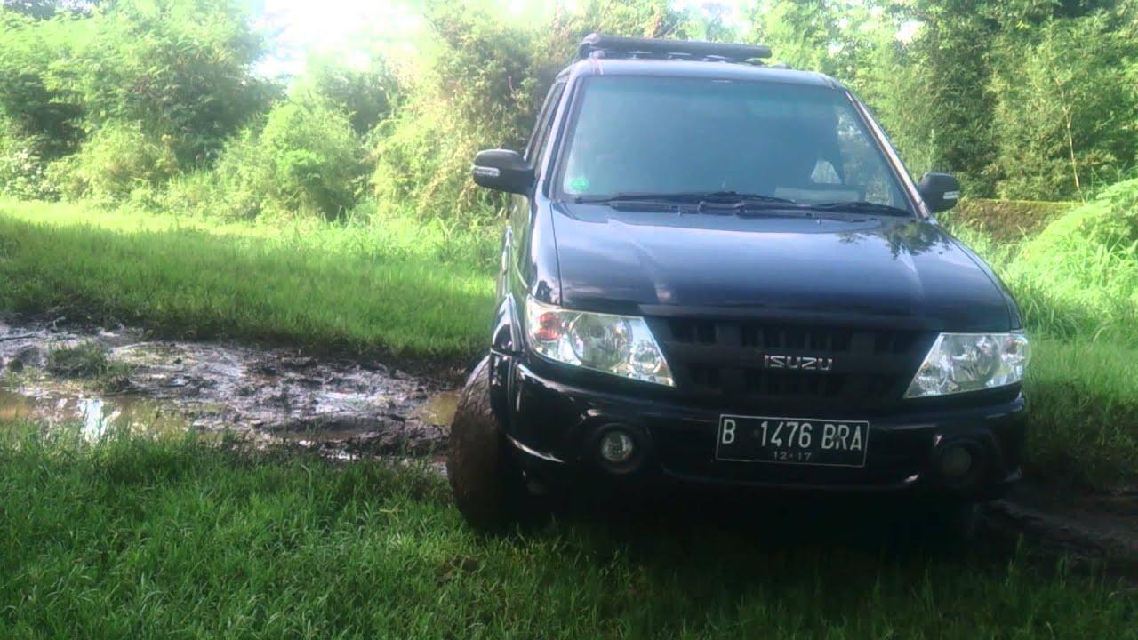Isuzu Panther Grandtouring -Mud Spot