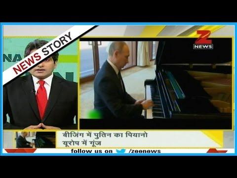 DNA: Vladimir Putin plays piano while waiting for Xi Jinping in Beijing