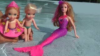 Elsa and Anna toddlers take swimming lessons from Romy the mermaid. Huge Pool - Underwater  filming