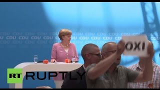 """Germany: """"Oxi!"""" Merkel interrupted by Greek solidarity protesters"""