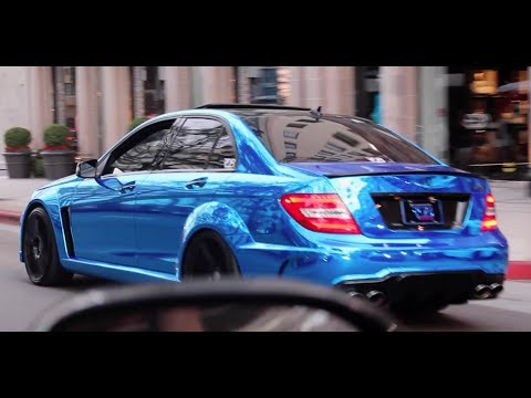 C63 Amg Sedan With Blue Chrome Wrap Cruising In Beverly