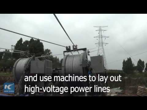 How are electric power transmission towers set up in China?