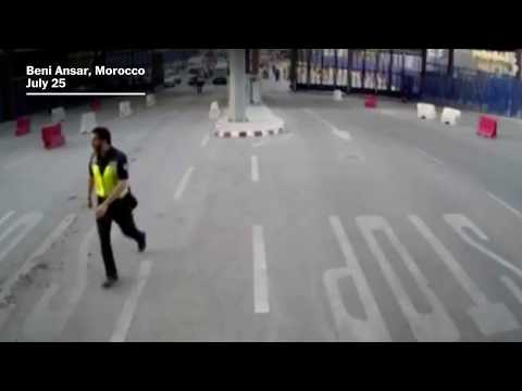 Spanish police throw traffic barrier at knife-wielding man