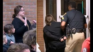 Teacher removed from Louisiana school meeting in HANDCUFFS