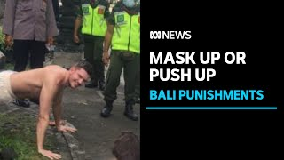 Foreigners in Bali punished with push-ups for not following coronavirus health protocols | ABC News