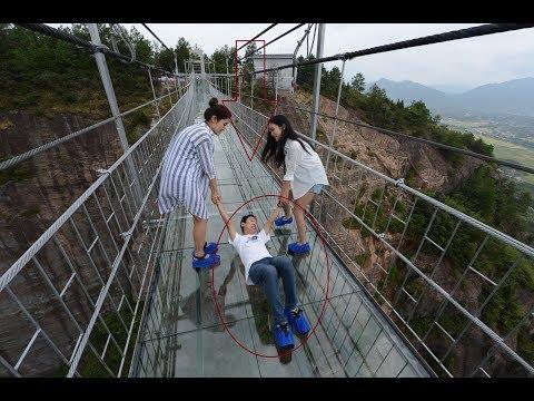 Download Youtube: China's glass walkway that cracks under weight 2017|China Glass Bridge Funny 2017