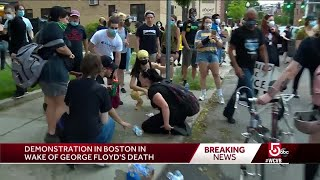 Chaos, clashes between police, protesters outside Boston precinct