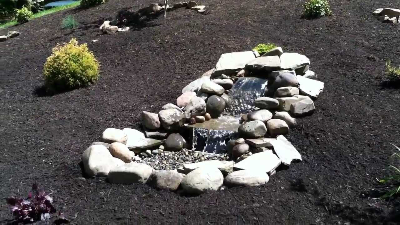 Pondless waterfall hillside landscape installation ideas for Waterfall installation