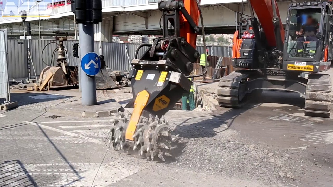 A MB-R900 drum cutter performing a trench to bring water from Buda to Pest