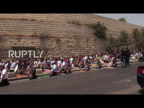 East Jerusalem: Palestinians pray outside Temple Mount amid continuing protests