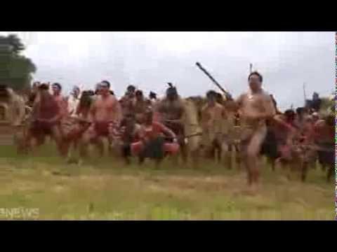 Hundreds of Maori warriors in battle haka