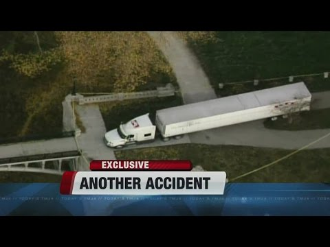 Truck driver that got stuck on footbridge knocked over light pole earlier that day