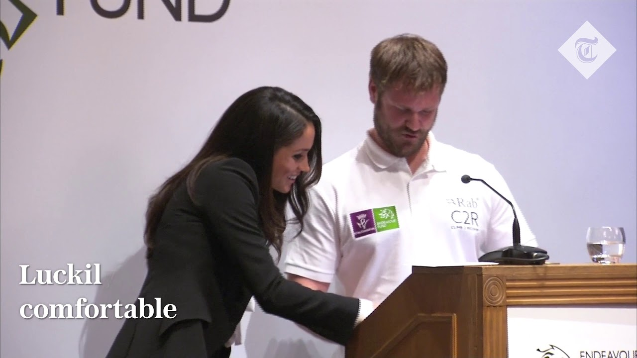 Meghan gets the giggles at awards mix-up