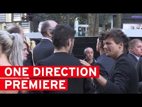 Louis Tomlinson looking very awkward with Perrie and Zayn at One Direction Premiere