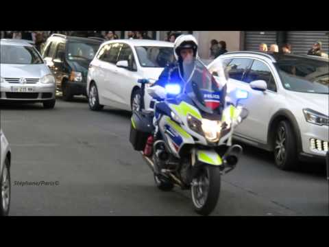 Police motorcycle escort, the president of zambia in traffic of Paris.