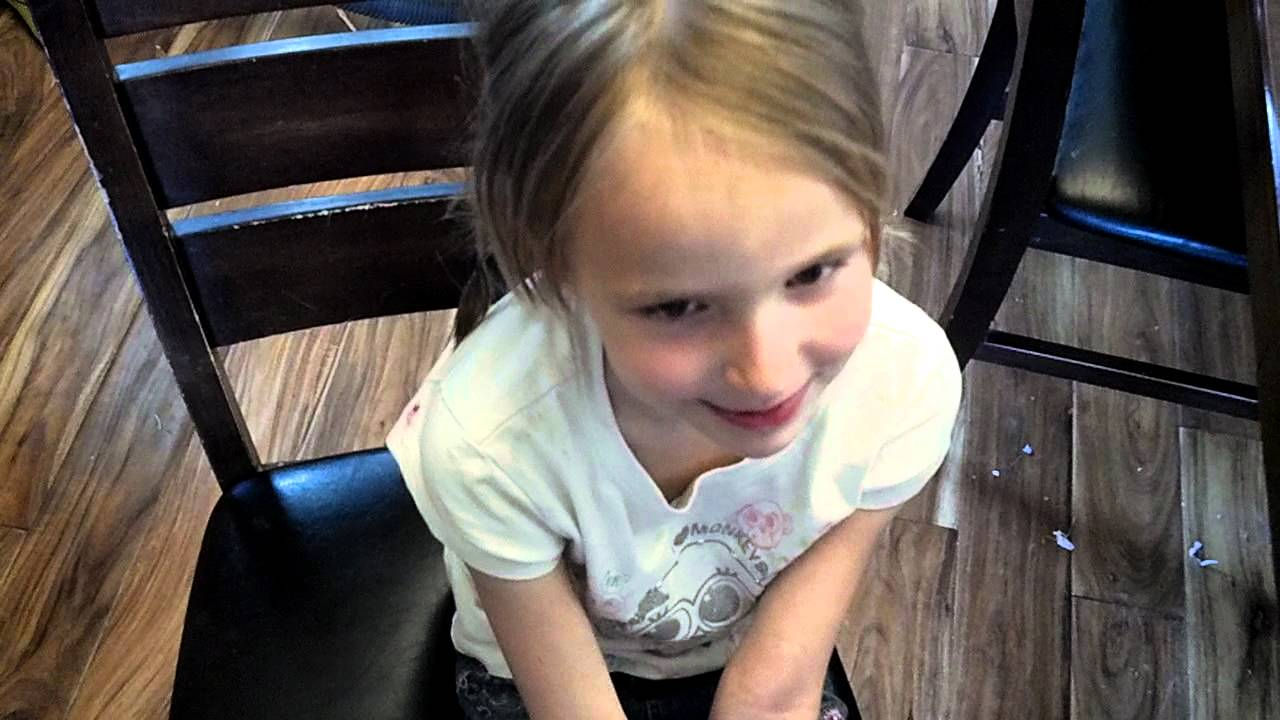 Cute little girl loose tooth
