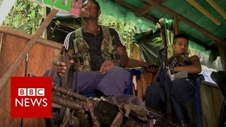 Rare look inside Farc rebel camp - BBC News
