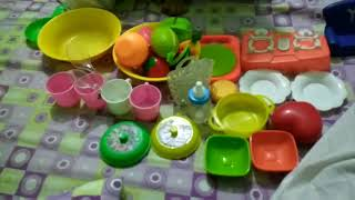 Kids playing with kitchen utensils