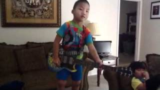 Zack playing with his guitar hero. Thumbnail