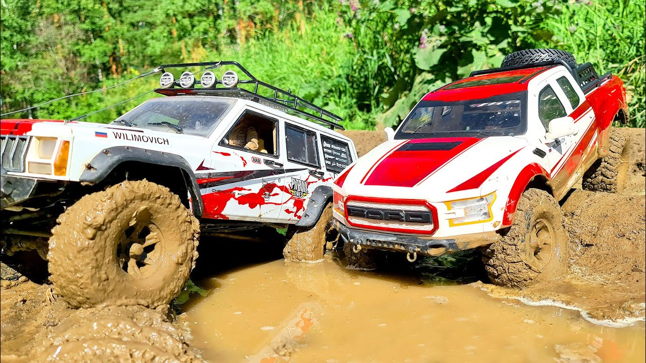 2 AMAZING RADIO CONTROL CARS RACE IN MUD — Jeep Cherokee and Ford Raptor