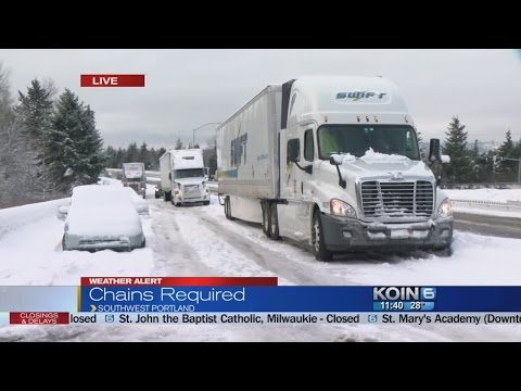 Tractor-trailers stuck on interstate ramp