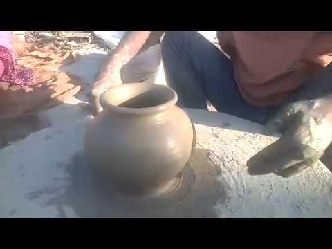 Making clay kuja or handi